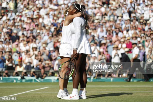 Germany's Angelique Kerber embraces US player Serena Williams following their women's singles final match on the twelfth day of the 2018 Wimbledon...