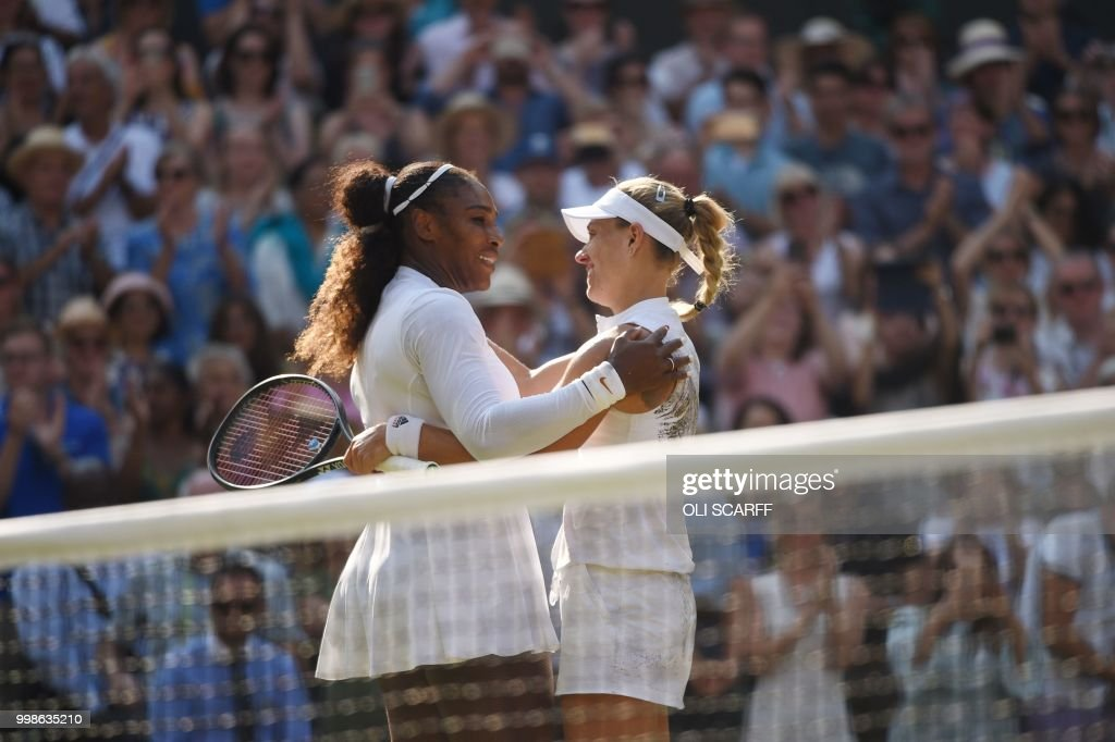 Germany's Angelique Kerber (R) embraces US player Serena Williams following their women's singles final match on the twelfth day of the 2018 Wimbledon Championships at The All England Lawn Tennis Club in Wimbledon, southwest London, on July 14, 2018. - Kerber won the match 6-3, 6-3. (Photo by Oli SCARFF / AFP) / RESTRICTED