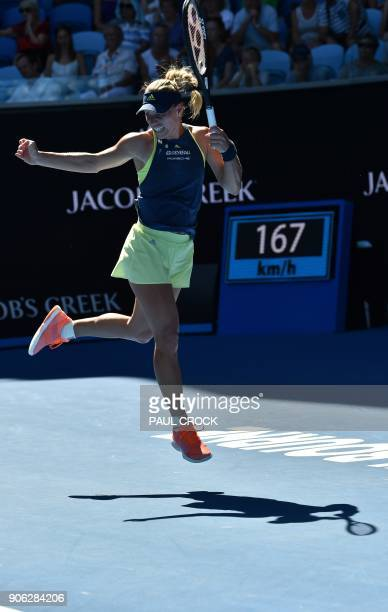 Germany's Angelique Kerber hits a return against Croatia's Donna Vekic during their women's singles second round match on day four of the Australian...
