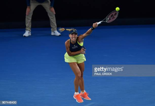 Germany's Angelique Kerber hits a return against during their women's singles third round match agaisnt Russia's Maria Sharapova on day six of the...