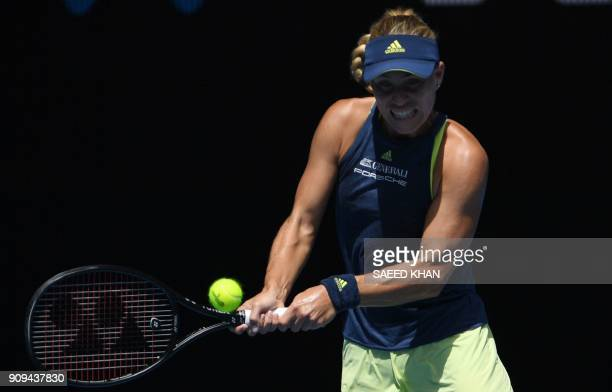Germany's Angelique Kerber hits a return against Madison Keys of the US during their women's singles quarterfinals match on day 10 of the Australian...