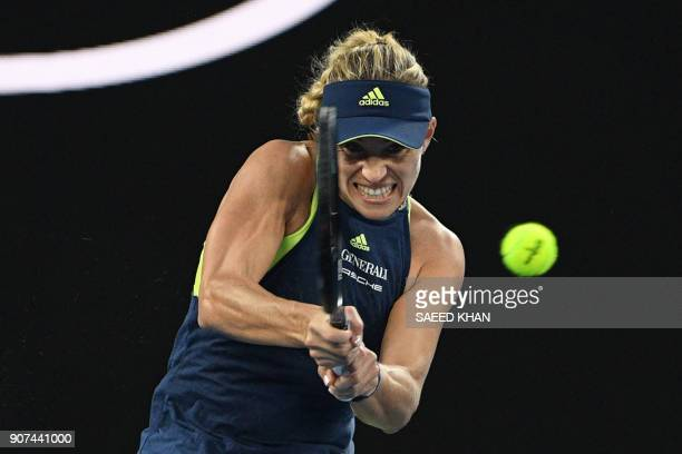 TOPSHOT Germany's Angelique Kerber hits a return against Russia's Maria Sharapova during their women's singles third round match on day six of the...