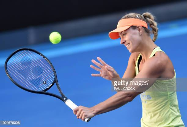 Germany's Angelique Kerber hits a return during a practice session ahead of the Australian Open tennis tournament in Melbourne on January 14 2018 /...