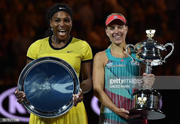 Germany's Angelique Kerber holds The Daphne Akhurst Memorial Cup as she celebrates after victory her women's singles final match against Serena...