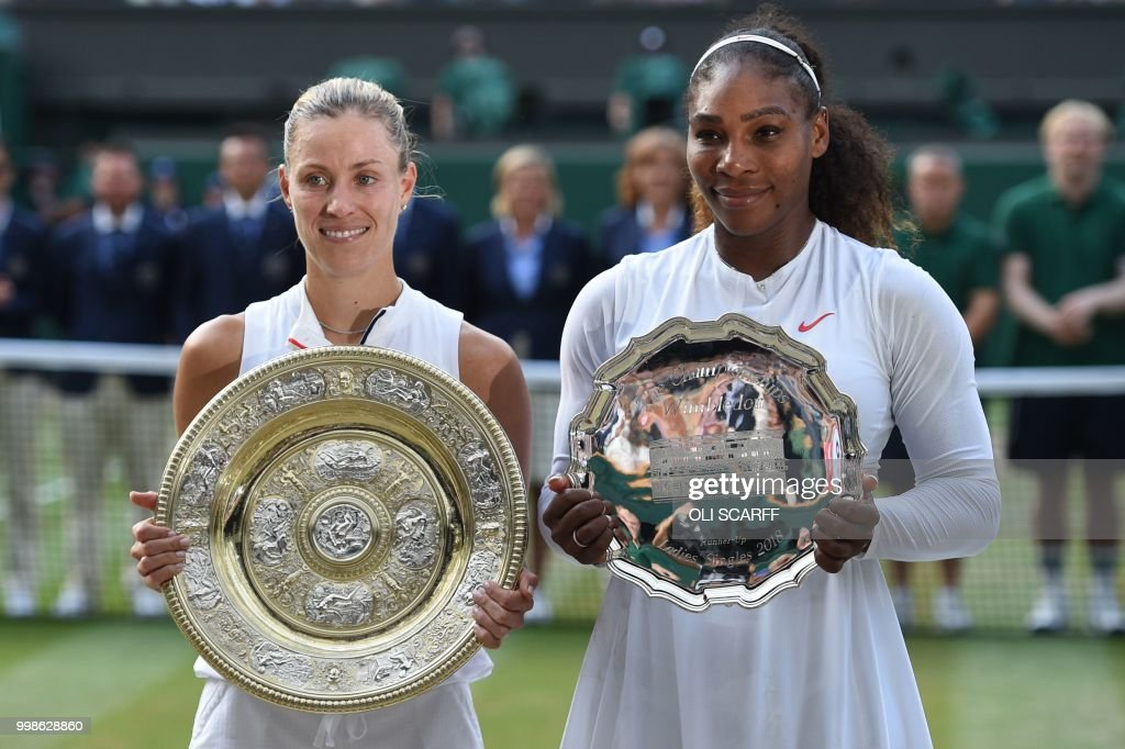 TOPSHOT - Germany's Angelique Kerber (L) holds the winner's trophy, the Venus Rosewater Dish, after her women's singles final victory over US player Serena Williams on the twelfth day of the 2018 Wimbledon Championships at The All England Lawn Tennis Club in Wimbledon, southwest London, on July 14, 2018. - Kerber won the match 6-3, 6-3. (Photo by Oli SCARFF / AFP) / RESTRICTED