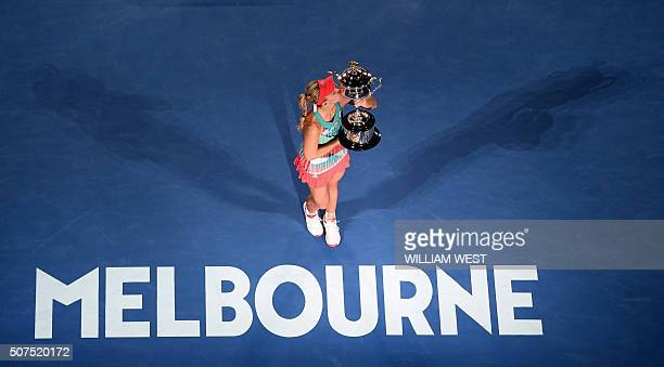 Germany's Angelique Kerber kisses The Daphne Akhurst Memorial Cup as she celebrates after victory in her women's singles final match against Serena...