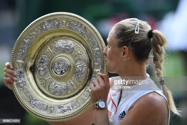 TOPSHOT Germany's Angelique Kerber kisses the winner's trophy the Venus Rosewater Dish after her women's singles final victory over US player Serena...