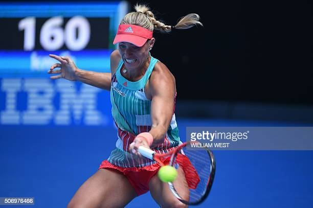 Germany's Angelique Kerber plays a forehand return during her women's singles match against Belarus's Victoria Azarenka on day ten of the 2016...