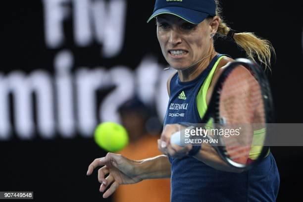 Germany's Angelique Kerber plays a forehand return to Russia's Maria Sharapova during their women's singles third round match on day six of the...
