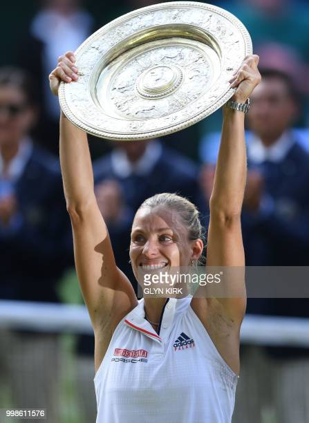 Germany's Angelique Kerber poses with the winner's trophy the Venus Rosewater Dish after her women's singles final victory over US player Serena...