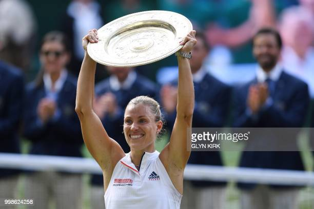 TOPSHOT Germany's Angelique Kerber poses with the winner's trophy the Venus Rosewater Dish after her women's singles final victory over US player...