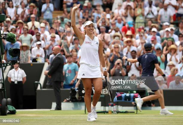 Germany's Angelique Kerber reacts after winning against Switzerland's Belinda Bencic during their women's singles fourth round match on the seventh...