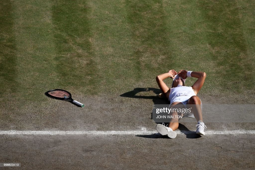 TOPSHOT - Germany's Angelique Kerber reacts after winning against US player Serena Williams during their women's singles final match on the twelfth day of the 2018 Wimbledon Championships at The All England Lawn Tennis Club in Wimbledon, southwest London, on July 14, 2018. - Kerber won the match 6-3, 6-3. (Photo by John WALTON / POOL / AFP) / RESTRICTED