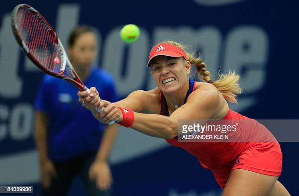 Germany's Angelique Kerber returns a ball against Serbia's Ana Ivanovic during their final match of the WTA tennis tournament in Linz Austria on...