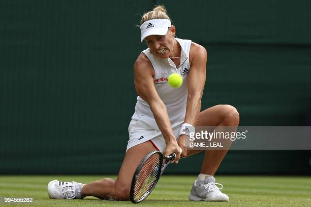 Germany's Angelique Kerber returns against Switzerland's Belinda Bencic during their women's singles fourth round match on the seventh day of the...