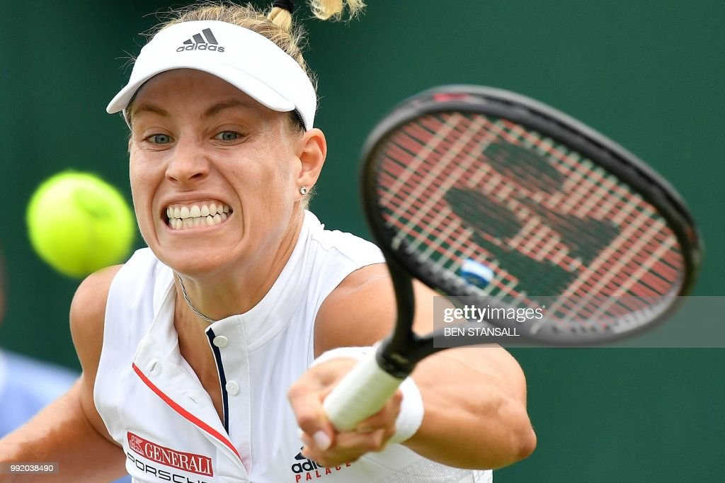 Germany's Angelique Kerber returns against US player Claire Liu during their women's singles second round match on the fourth day of the 2018 Wimbledon Championships at The All England Lawn Tennis Club in Wimbledon, southwest London, on July 5, 2018. (Photo by Ben STANSALL / AFP) / RESTRICTED
