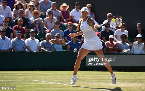 Germany's Angelique Kerber returns against US player Shelby Rogers during their women's singles third round match on the sixth day of the 2017...
