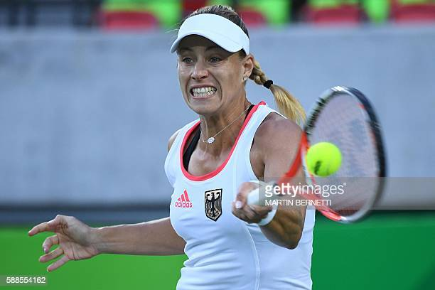 Germany's Angelique Kerber returns the ball to Britain's Johanna Konta during their women's singles quarter-final tennis match at the Olympic Tennis...