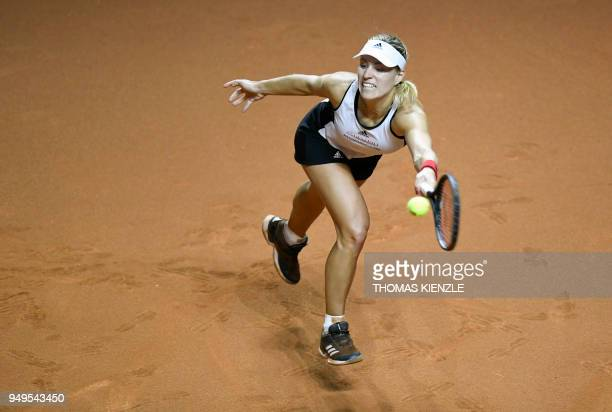 Germany's Angelique Kerber returns the ball to Czech's Karolina Pliskova during their match of the tennis Fed Cup semifinal between Germany and Czech...