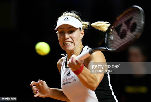 Germany's Angelique Kerber returns the ball to Czech's Petra Kvitova during their match of the tennis FedCup World Group semifinal between Germany...