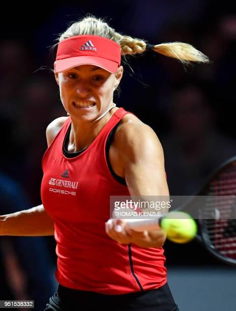 Germany's Angelique Kerber returns the ball to Estonia's Anett Kontaveit during the WTA Porsche Tennis Grand Prix in Stuttgart southwestern Germany...