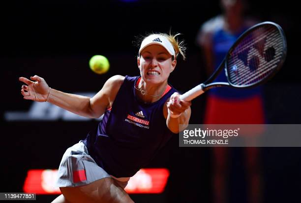 Germany's Angelique Kerber returns the ball to Netherlands' Kiki Bertens during their quarter-final match at the WTA Tennis Grand Prix in Stuttgart,...