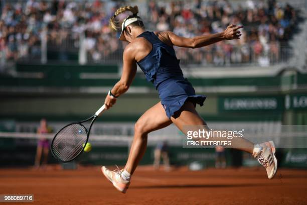 Germany's Angelique Kerber returns the ball to Netherlands' Kiki Bertens during their women's singles third round match on day seven of The Roland...