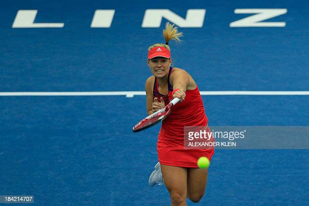 Germany's Angelique Kerber returns the ball to Spain's Carla Suarez Navarro during their semi final match as part of the WTA tennis tournament held...