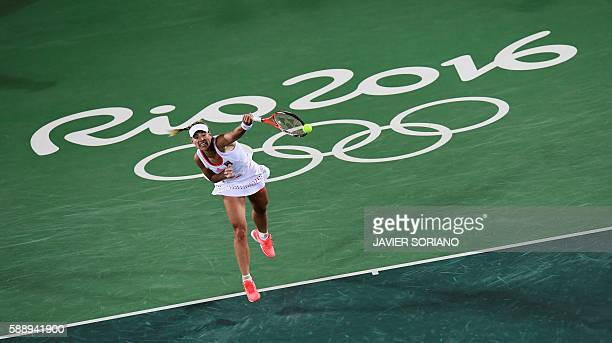 Germany's Angelique Kerber returns the ball to US player Madison Keys during their women's singles semi-finals tennis match at the Olympic Tennis...