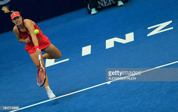 Germany's Angelique Kerber serves the ball to Spain's Carla Suarez Navarro during their semi final match as part of the WTA tennis tournament held in...