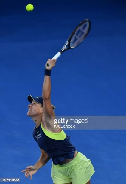 Germany's Angelique Kerber serves to Russia's Maria Sharapova in their women's singles third round match on day six of the Australian Open tennis...