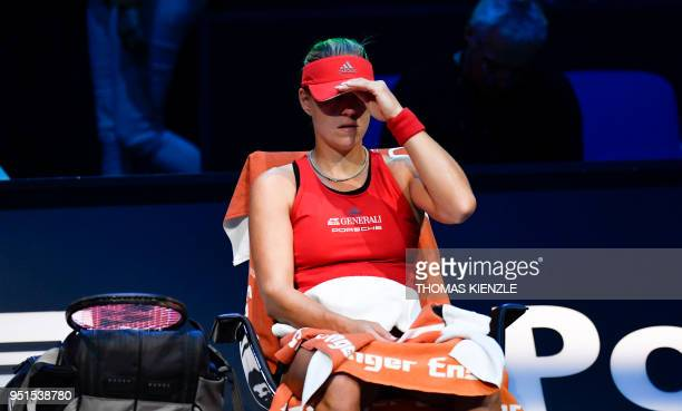 Germany's Angelique Kerber sits on a chair during a break in her match against Estonia's Anett Kontaveit at the WTA Porsche Tennis Grand Prix in...