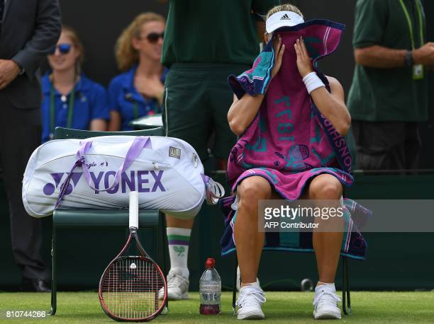 Germany's Angelique Kerber uses a towel during a break in play against US player Shelby Rogers during their women's singles third round match on the...