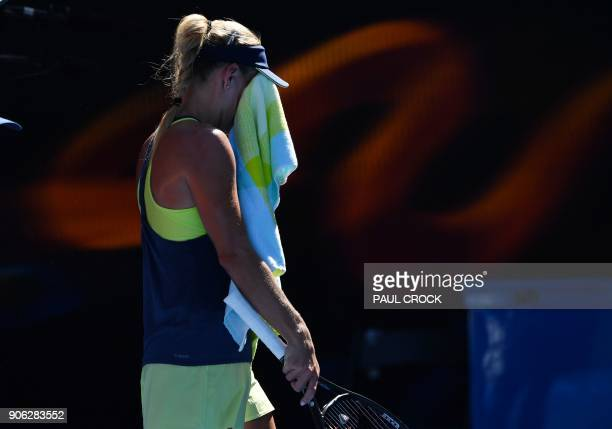 Germany's Angelique Kerber uses a towel during their women's singles second round match against Croatia's Donna Vekic on day four of the Australian...