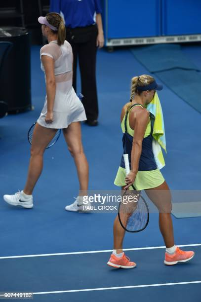 Germany's Angelique Kerber walks past Russia's Maria Sharapova during their women's singles third round match on day six of the Australian Open...