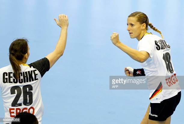 Germany's Angie Geschake and Laura Steinbach celebrate during their Women's Handball World Championship 2013 eightfinal match Germany vs Angola on...