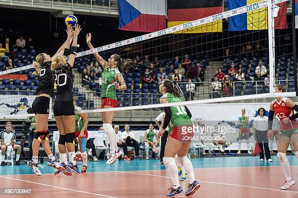 Germany's Anja Brandt and Germany's Mareen Apitz defend against Petra Szeles during the womens European Volleyball Championship between Germany and...