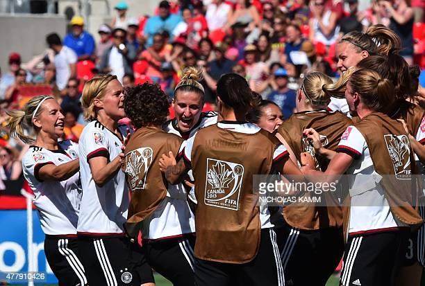 Germany's Anja Mittag celebrates scoring a goal with teammates during their 2015 FIFA Women's World Cup football round of 16 match between Sweden and...