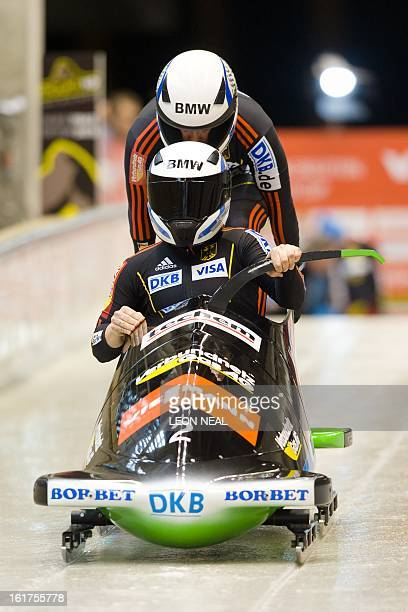 Germany's Anja Schneiderheinze and Stephanie Schneider take part in the first run during the Women's Bobsleigh competition at the Sanki Sliding...