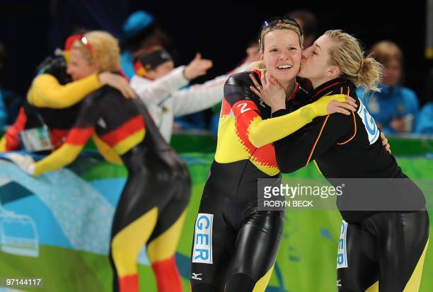 Germany's Anna FriesingerPostma kisses teammate Stephanie Beckert after the German team won the gold medal in the women's 2010 Winter Olympics...