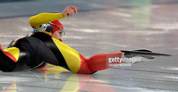 Germany's Anna FriesingerPostma stretches to cross the finish line after falling to the track in the Ladies' team pursuit speedskating semifinals at...