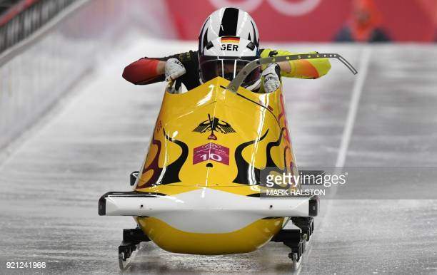 Germany's Anna Koehler and Germany's Erline Nolte compete in the women's bobsleigh heat 1 run during the Pyeongchang 2018 Winter Olympic Games at the...