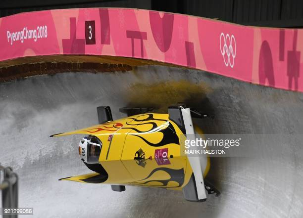 Germany's Anna Koehler and Germany's Erline Nolte compete in the women's bobsleigh heat 2 run during the Pyeongchang 2018 Winter Olympic Games at the...