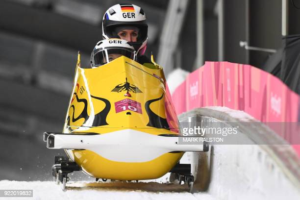 Germany's Anna Koehler and Germany's Erline Nolte compete in the women's bobsleigh heat 3 run during the Pyeongchang 2018 Winter Olympic Games at the...