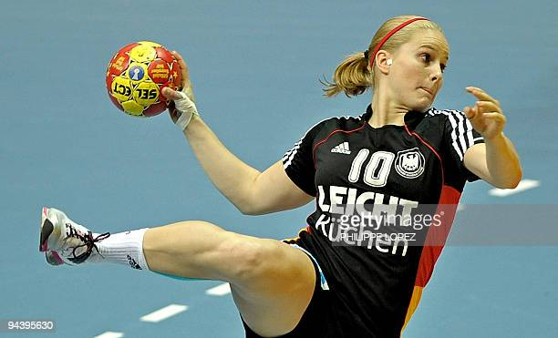 Germany's Anna Loerper aims a shot during the main round match between Austria and Germany at the women's handball world championships in Yangzhou on...