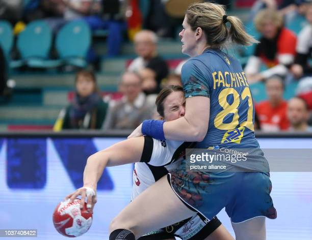 Germany's Anna Loerper and Brazil's Deonise Fachinello in action during the World Women's Handball Championships match between Brazil and Germany in...