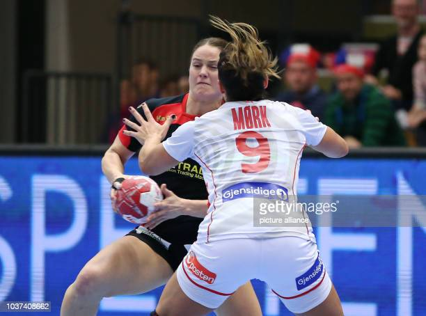 Germany's Anna Loerper and Norway's Nora Moerk vie for the ball during the World Women's HandballChampionship match between Germany and Norway in...