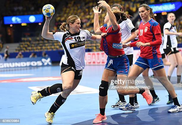 Germany's Anna Loerper prepares to throw the ball during the Women's European Handball Championship Group I match between Serbia and Germany in...