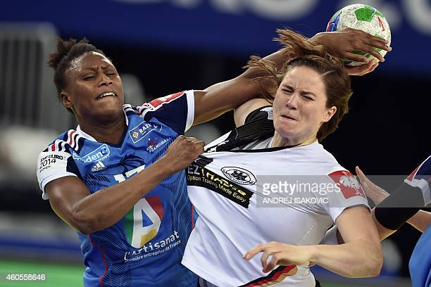 Germany's Anna Loerper vies with France's Siraba Dembele during the Main Round Group 2 handball match between Germany and France at the 2014 Women's...