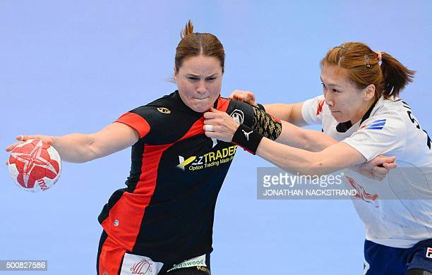 Germany's Anna Loerper vies with South Korea's Haein Sim during the 2015 Women's Handball World Championship group C match between Germany and South...
